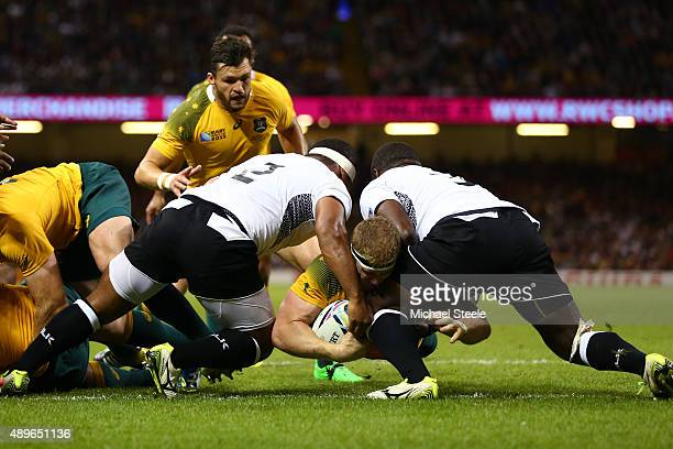 David Pocock of Australia goes over to score the opening try during the 2015 Rugby World Cup Pool A match between Australia and Fiji at the...