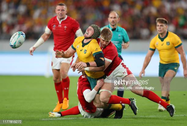 David Pocock of Australia is tackled by Aaron Wainwright and Rhys Patchell of Wales during the Rugby World Cup 2019 Group D game between Australia...
