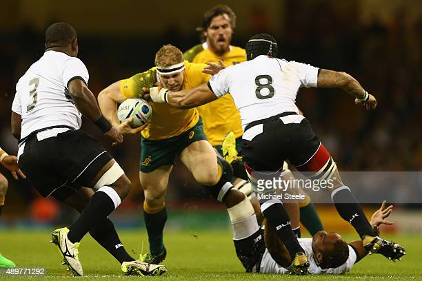 David Pocock of Australia is tackled by Netani Talei of Fiji during the 2015 Rugby World Cup Pool A match between Australia and Fiji at Millennium...
