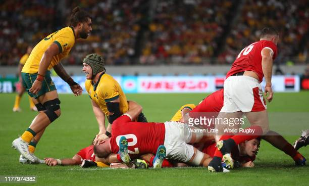 David Pocock of Australia wrestles with Ross Moriarty of Wales during the Rugby World Cup 2019 Group D game between Australia and Wales at Tokyo...