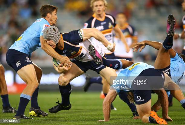 David Pocock of the Brumbies runs the ball during the round seven Super Rugby match between the Brumbies and the Waratahs at GIO Stadium on March 31...