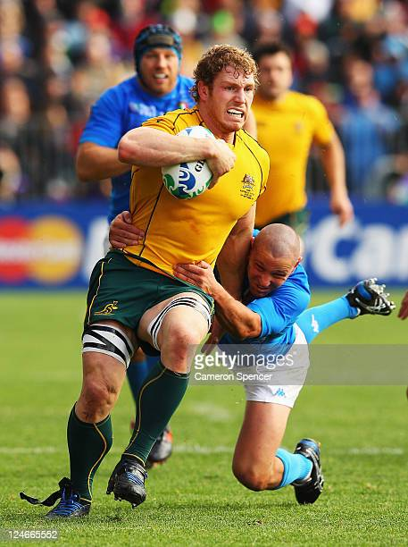 David Pocock of the Wallabies is tackled by Fabio Semenzato of Italy during the IRB 2011 Rugby World Cup Pool C match between Australia and Italy at...