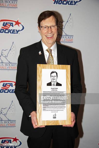 David Poile poses with his Hall of Fame plaque at the U.S. Hockey Hall Of Fame Induction on December 12, 2018 in Nashville, Tennessee.