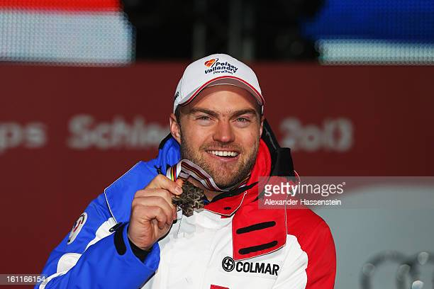 David Poisson of France celebrates with his bronze medal at the medal ceremony after finishing third in the Men's Downhill during the Alpine FIS Ski...