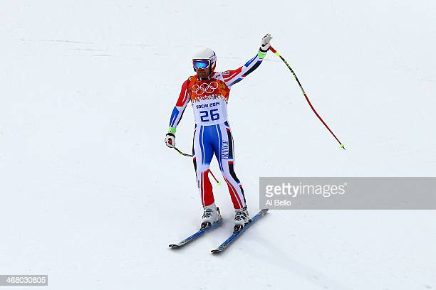 David Poisson of France finshes a run during the Alpine Men's Downhill on day two of the Sochi 2014 Winter Olympics at Rosa Khutor Alpine Center on...