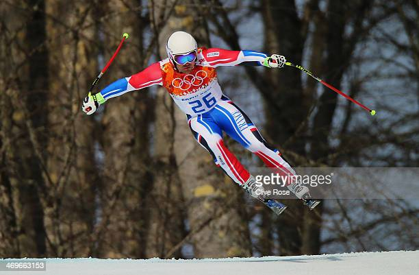 David Poisson of France skis during the Alpine Skiing Men's SuperG on day 9 of the Sochi 2014 Winter Olympics at Rosa Khutor Alpine Center on...