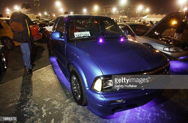 David Polites stands next to his modified 1995 Chevy S10 at the RaceLegalcom drag race at Qualcomm Stadium December 13 2002 in San Diego California...