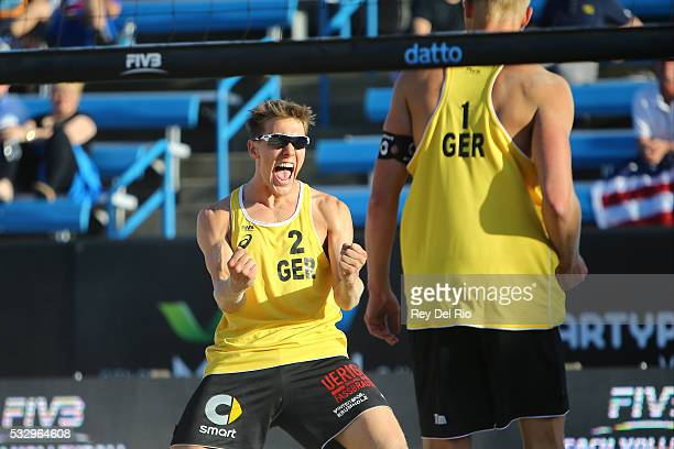 David Poniewaz of Germany celebrates during the match against Todd Rogers and Robbie Page of the USA during day 3 of the 2016 AVP Cincinnati Open on...