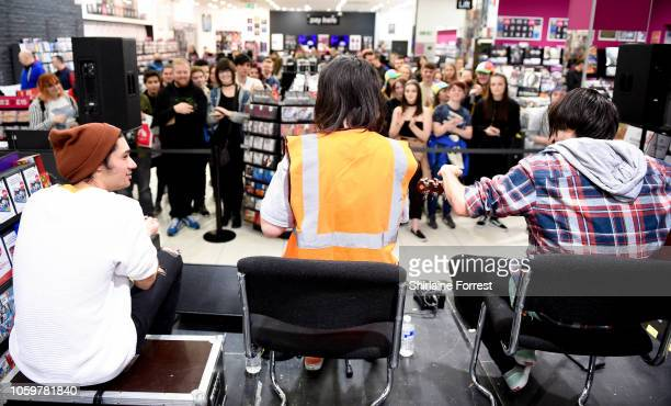 David Potter, Bonnie Fraser and Jonno Panichi of Stand Atlantic perform live and sign copies of their new album 'Skinny Dipping' during an in store...