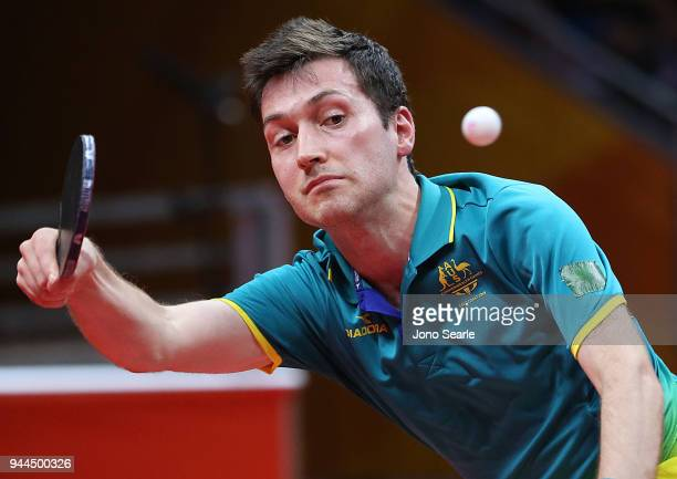 David Powell and Miao Miao of Australia compete against Mo Zhang and Zhen Wang of Canada in the Mixed Doubles Round of 32 during Table Tennis on day...