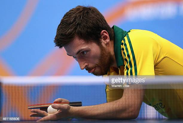 David Powell of Australia in action against Ruwen Filus of German in the Men's Group 2 match during day one of the ITTF World Team Cup at the Al Nasr...