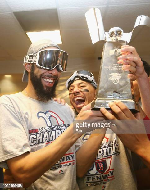 David Price and Mookie Betts of the Boston Red Sox celebrate with the William Harridge Trophy in the clubhouse after defeating the Houston Astros 41...