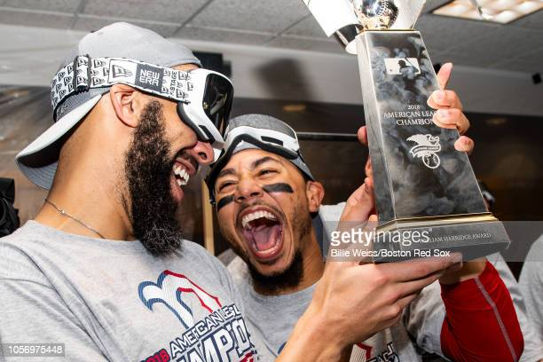 David Price and Mookie Betts of the Boston Red Sox celebrate with the American League Championship Series trophy in the clubhouse after clinching the...