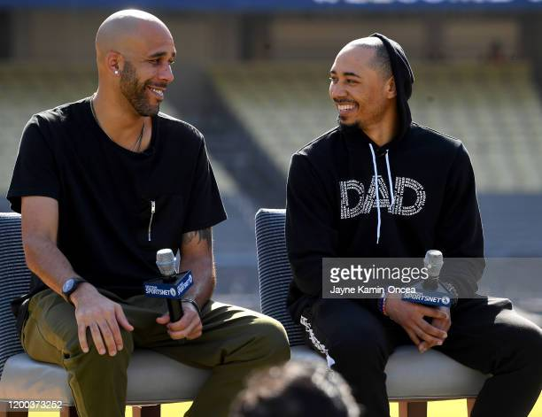 David Price and Mookie Betts of the Los Angeles Dodgers answer questions from the media during an introductory news conference at Dodger Stadium on...