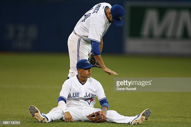 David Price gives Ryan Goins a pat after he nearly threw out Abraham Almonte out at first on a weak infield grounder as the Toronto Blue Jays play...