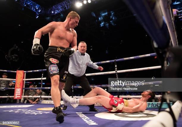 David Price is knocked down by Alexander Povetkin during thier WBA InterContinental Heavyweight WBO International Heavyweight Championship title...
