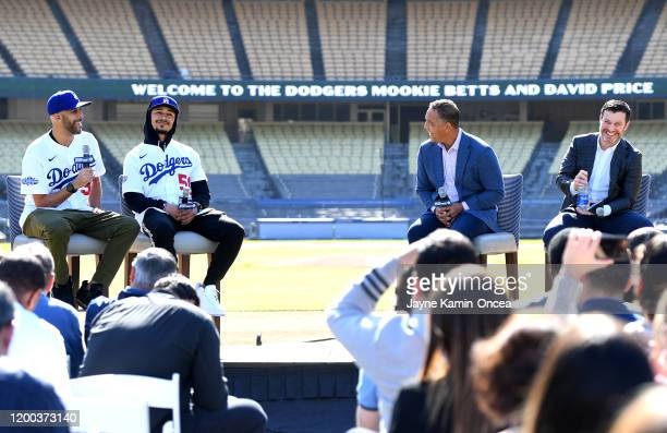 David Price Mookie Betts manager Dave Roberts and general manager Andrew Friedman of the Los Angeles Dodgers answer questions during an introductory...