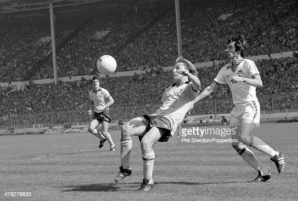 David Price of Arsenal is challenged by Alan Devonshire of West Ham United during the FA Cup Final at Wembley Stadium in London 10th May 1980 West...