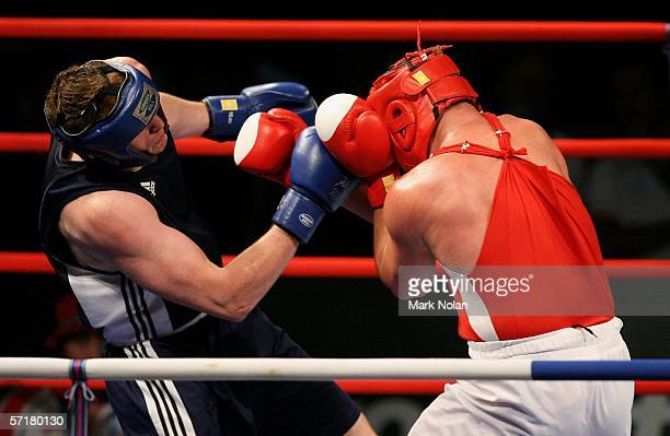 David Price of England in action against Kevin Evans of Wales in the Super Heavyweight91 kg Gold Medal Bout during the boxing at the Melbourne...