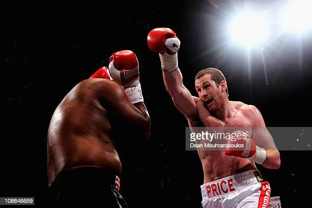 David Price of England lands a punch on Osbourne Machimana of South Africa in their Commonwealth Title Eliminator fight at the Brentwood Leisure...