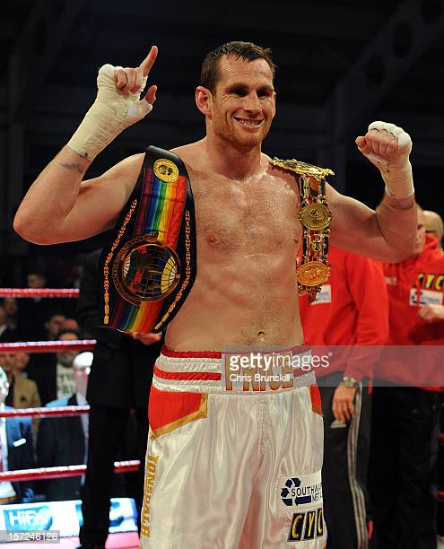 David Price of England poses with the belts following his British Commonwealth Heavyweight title fight against Matt Skelton of England at Aintree...