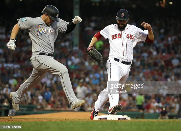 David Price of the Boston Red Sox beats Austin Dean of the Miami Marlins for the out at first base in the third inning at Fenway Park on August 29...