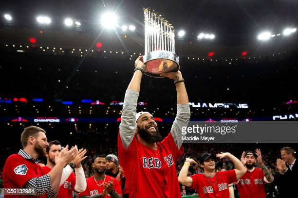 David Price of the Boston Red Sox celebrates with The Commissioner's Trophy during the first quarter of the game between the Boston Celtics and the...