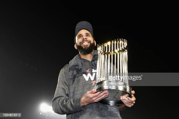 David Price of the Boston Red Sox celebrates with the World Series trophy after his team's 51 win over the Los Angeles Dodgers in Game Five to win...
