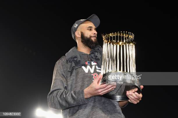 David Price of the Boston Red Sox celebrates with the World Series trophy after his team defeated the Los Angeles Dodgers 51 in Game Five of the 2018...