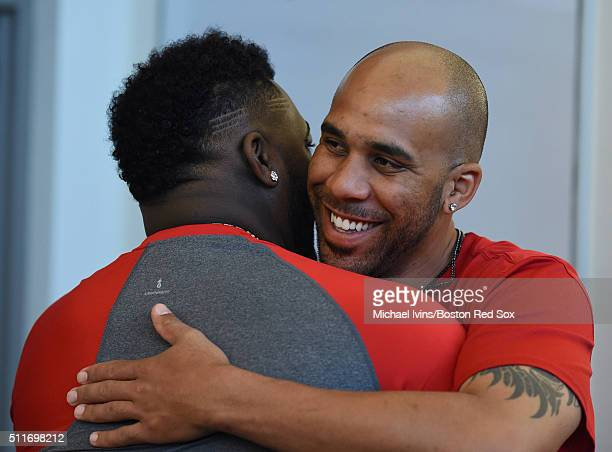 David Price of the Boston Red Sox hugs David Ortiz upon his arrival in the clubhouse on February 22 2016 at Fenway South in Fort Myers Florida