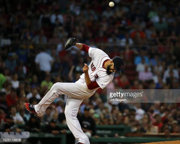 David Price of the Boston Red Sox is hit by a ball off the bat of Austin Dean of the Miami Marlins in the third inning at Fenway Park on August 29...