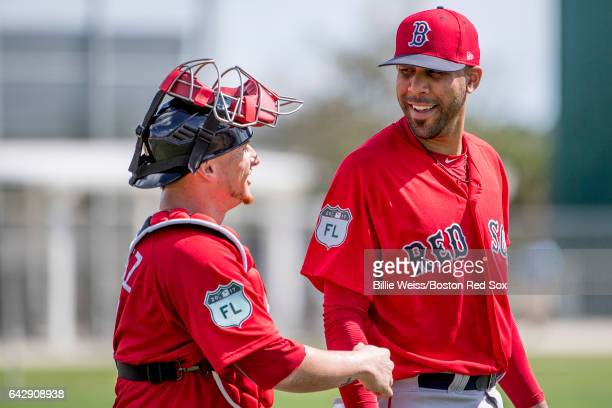 David Price of the Boston Red Sox reacts with Christian Vazquez during a team workout on February 19 2017 at Fenway South in Fort Myers Florida