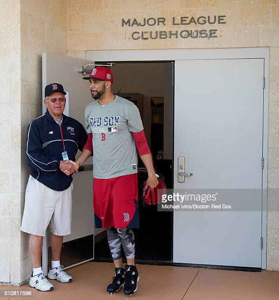 David Price of the Boston Red Sox shakes hands with security guard John Ruzanski while taking the practice field for a Spring Training workout at...