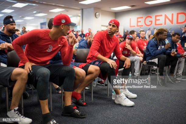 David Price of the Boston Red Sox talks with Rick Porcello before the start of a team meeting on February 17 2017 at jetBlue Park in Fort Myers...