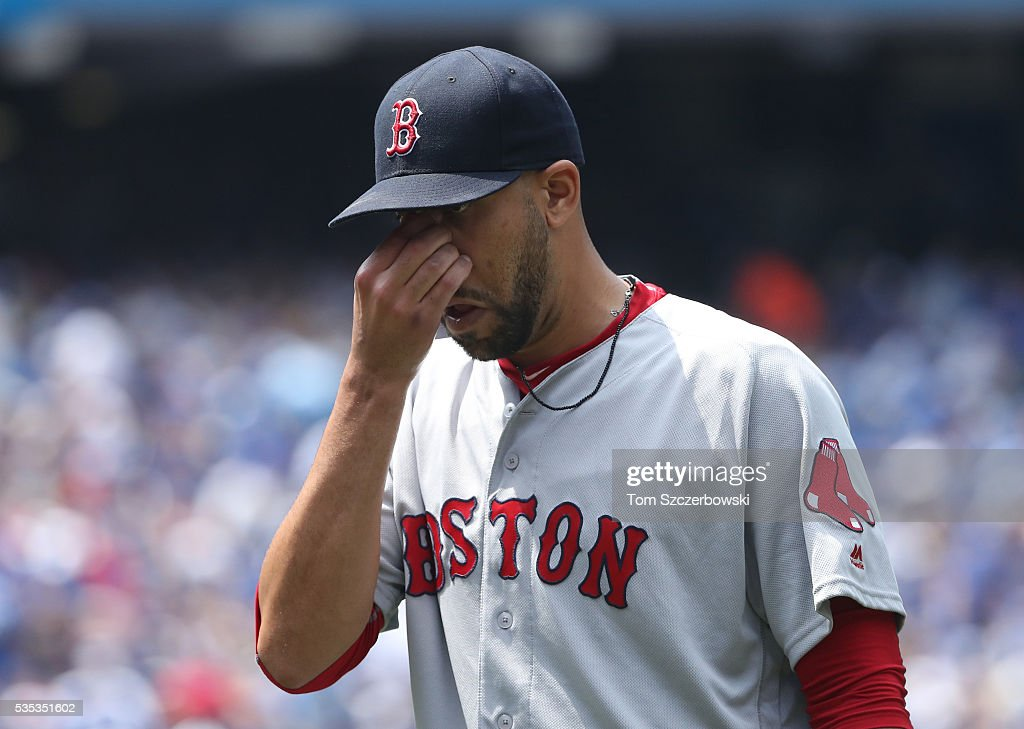 David Price #24 of the Boston Red Sox walks to the dugout after getting the last out of the first inning during MLB game action against the Toronto Blue Jays on May 29, 2016 at Rogers Centre in Toronto, Ontario, Canada.