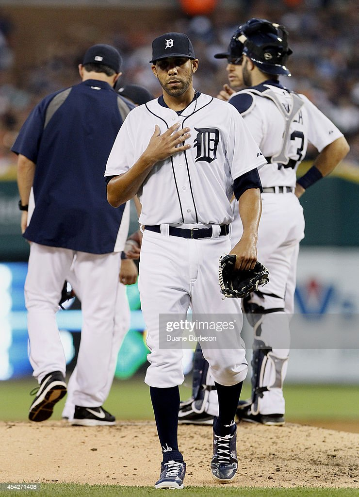 David Price #14 of the Detroit Tigers walks off the mound after being pulled by Manager Brad Ausmus #7, left, during the third inning of a game against the New York Yankees at Comerica Park on August 27, 2014 in Detroit, Michigan. Price gave up eight runs on 12 hits in a 8-4 loss to the Yankees.