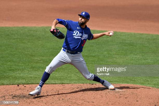David Price of the Los Angeles Dodgers delivers a fourth inning pitch against the Cleveland Indians during a spring training game at Goodyear...