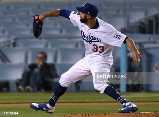 David Price of the Los Angeles Dodgers pitches in relief during the eighth inning against the Colorado Rockies at Dodger Stadium on April 13, 2021 in...