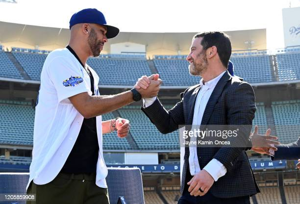 David Price of the Los Angeles Dodgers shakes hands with general manager Andrew Friedman as he is introduced at a press conference at Dodger Stadium...