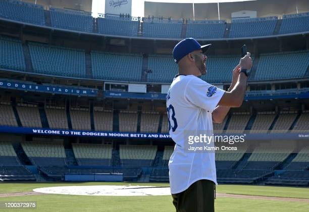 David Price of the Los Angeles Dodgers takes a video as he stands on the pitchers mound after an introductory press conference at Dodger Stadium on...