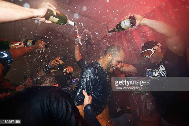 David Price of the Tampa Bay Rays celebrates with teammates after their 5 to 2 win over the Texas Rangers in the American League Wild Card tiebreaker...