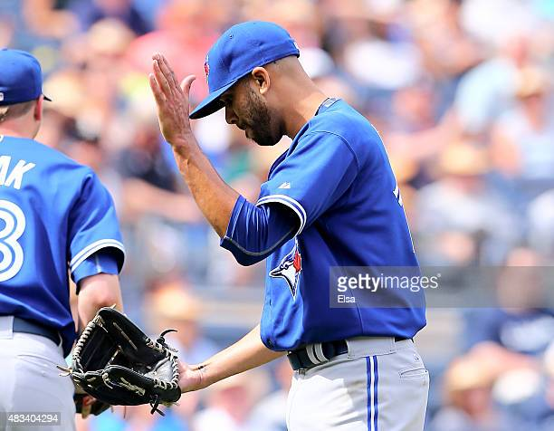 David Price of the Toronto Blue Jays celebrates the final out of the seventh inning against the New York Yankees on August 8 2015 at Yankee Stadium...