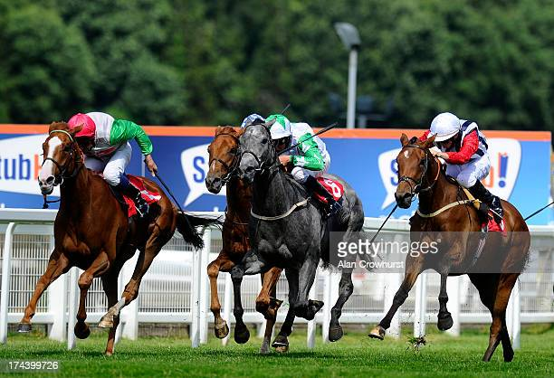 David Probert riding Debdebdeb win The Weatherbys VAT Services Handicap Stakes at Sandown racecourse on July 25 2013 in Esher England