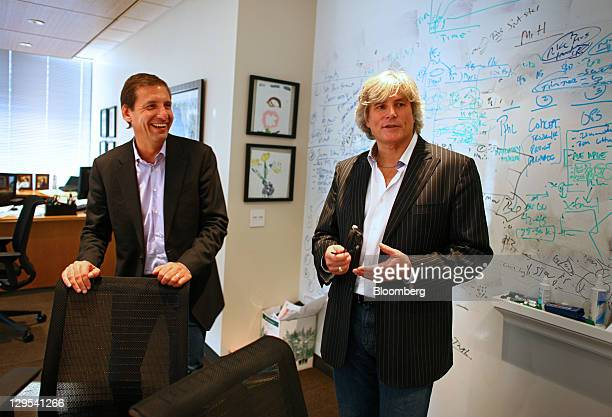 David Prokupek, chairman and chief executive officer of Smashburger Master LLC, left, smiles while Founder and Chief Concept Officer Tom Ryan speaks...