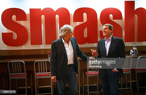 David Prokupek, chairman and chief executive officer of Smashburger Master LLC, left, speaks while Founder and Chief Concept Officer Tom Ryan listens...