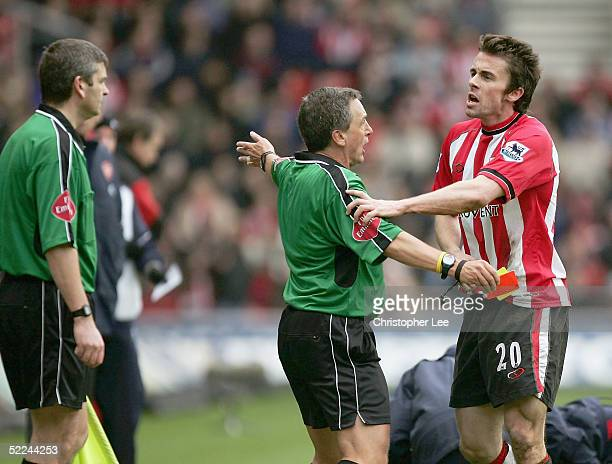 David Prutton of Southampton is held back by referee Alan Wiley as he argues with the linesman after he is sent off during the Barclays Premiership...