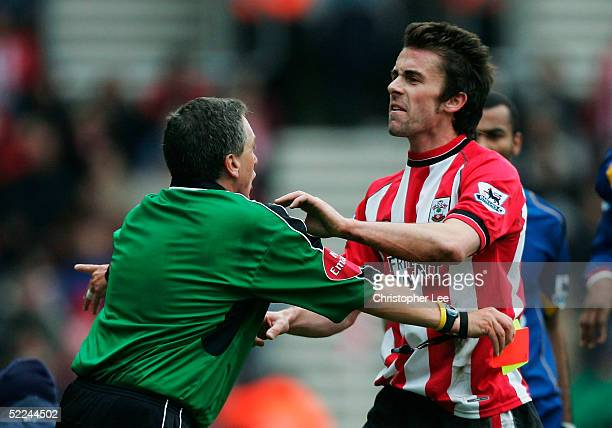 David Prutton of Southampton pushes the referee Alan Wiley as he tries to get to the linesman after he is sent off during the Barclays Premiership...