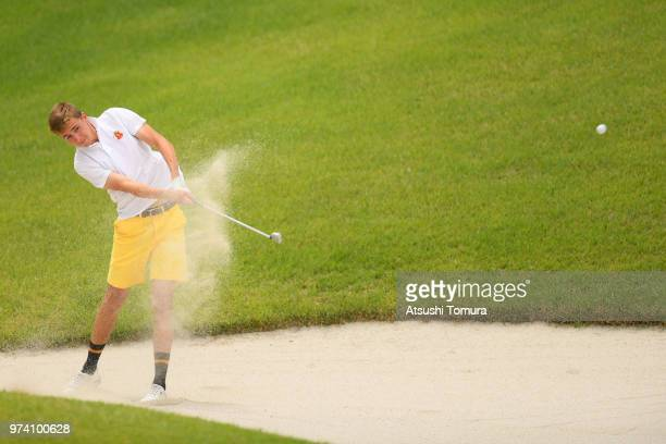 David Puig Currius of Spain lhits from a bunker on the 13th hole during the third round of the Toyota Junior Golf World Cup at Chukyo Golf Club on...