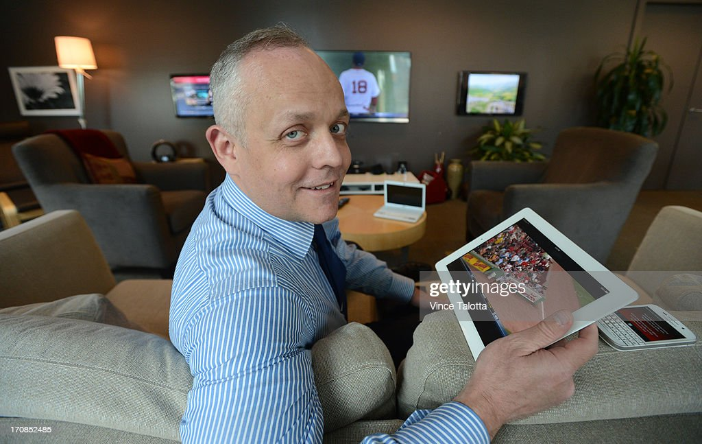 David Purdy, senior vice president of content for Rogers uses his laptop, iphone, tablet while watching TV. A study by rogers says 7 out of 10 Canadians do this. Shot at the Rogers building downtown