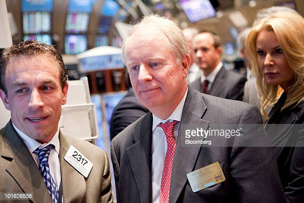 David Pyott chairman and chief executive officer of Allergan Inc right talks with trader Christopher Trotta on the floor of the New York Stock...